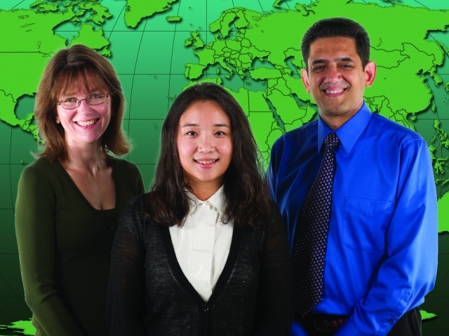 ISyE Professor Sigrun Andradottir, ISyE Ph.D. student Mi Lim Lee, and Emory University BIostatistician Azhar Nizam standing in front of world map
