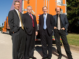 Four Professors standing in front of semi-truck
