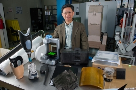 Chuck Zhang in manufacturing lab.