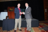John J. Bartholdi III (right) accepts award from Mike Ogle, managing director of the College Industry Council on Material Handling Education. Not pictured is co-author Steven Hackman.