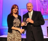 Julie Swann receives Atlanta Business Chronicle's 40 Under 40 Award. (photo by Byron Small/Atlanta Business Chronicle)