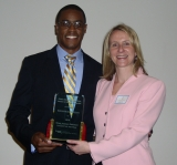 Emmanuel Miller, 2010 Work Abroad Student of the Year,  with Debbie Gulick, director of Work Abroad Programs and interim executive director, Division of Professional Practice