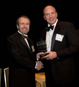 J. Louis Fouts (right) receives Distinquished Engineering Alumni Award from Dean Giddens