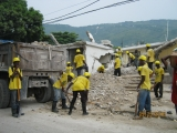 Workers remove debris in Haiti