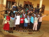 Kaitlin Rizk with the group of girls she helped mentor in a small Ugandan village.