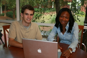 Adjoa Aka (R) and Adam Drozek (L), EWB-GT project leader and civil engineering student, review the group's water distribution plans for Cameroon.