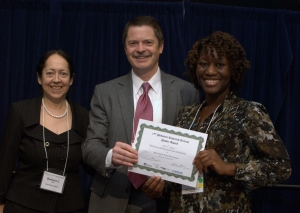 Sheila Isbell (right), Georgia Tech Research Institute, accepts poster award from Paul Spearman, MD, and Barbara Stoll, MD, Children's Healthcare of Atlanta.