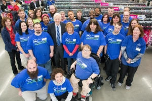 "Jim McClelland with a group of Goodwill employees at the Noblesville, Indiana store. In preparation for stepping down as CEO of the central Indiana Goodwill organization, McClelland went on a ""farewell tour"" of all the region's facilities in spring 2015."
