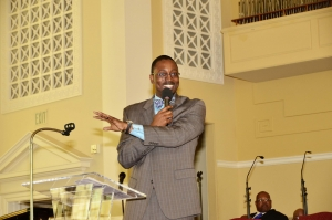 Damon P. Williams delivering a sermon from his church pulpit