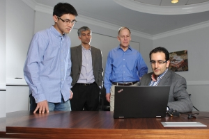 From left to right: ISyE Ph.D. student Can Zhang, Professor Roshan Vengazhiyil, Schneider National Chair in Transportation and Logistics Chelsea White III, and George Family Foundation Assistant Professor Turgay Ayer