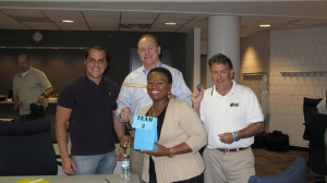 Picture taken of the winning team  - (back left Gabriel Pernia, Importadora Permar, back middle Tom Green,  PRTM Consulting, Bruce Oswald, Newell Rubbermaid, front center Ruth  Nymanza, Ciba Vision)