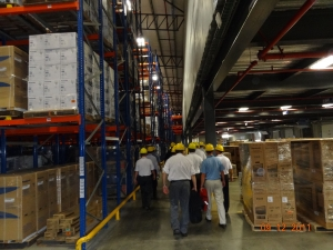 Group picture at the J.Cain warehouse in Lima, Peru