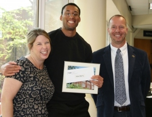 Director of Student Services Dawn Strickland and ISyE School Chair Edwin Romeijn with Alex Berry, recipient of the IISE Excellence in Leadership Award