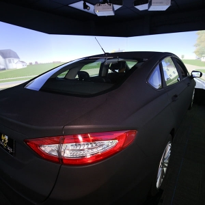 The new driving simulator lab includes this full-size Ford Fusion and two smaller desktop simulators that can interact in the simulated environment.