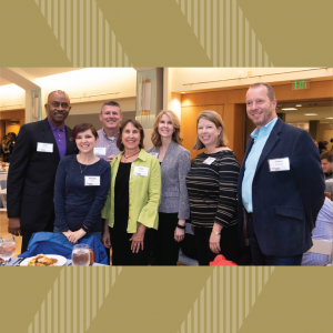 ISyE Academic Advisor Fran Buser (in green jacket) with colleauges at the 2019 Faculty & Staff Honors Luncheon: Ron Johnson, Brandy Blake, Jon Lowe, Carole Bennett, Dawn Strickland, and School Chair Edwin Romeijn