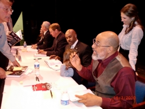 Ron Johnson (seated third from left) talking with his five-year-old godson, Eli Easley, at a Wilmington, North Carolina, book panel. Standing is Eli's mohter, Tara Easley (Mrs Hawaii International 2002).