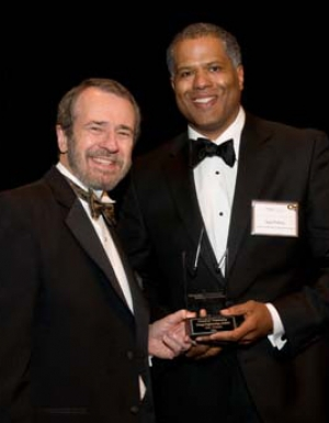 Guy Primus (right) accepts Outstanding Young Engineering Alumni Award from Dean Giddens