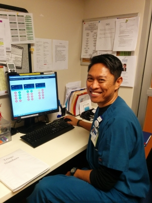 Emory Winship Triage nurse using the Real-time Visibility Tool to seat a patient.