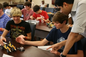 Industry representatives from Caterpillar Inc. played a supply chain game with the students to demonstrate principles in manufacturing and supply chain logistics.