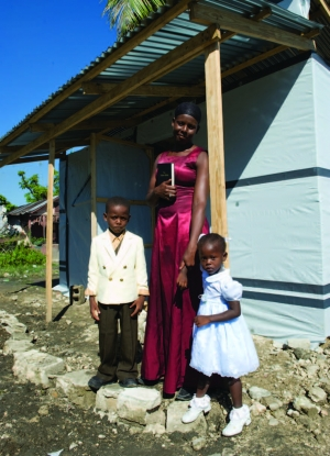 Flore Charles and her children received a Habitat for Humanity transitional shelter.