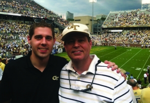 Matlock, IE 2011, and Ed Rogers, IE 1982, MS IL 2002, enjoying a Georgia Tech football game in 2012. Ed is a director of Global Strategy at UPS and Matlock works for Anheuser-Bush as a project manager.