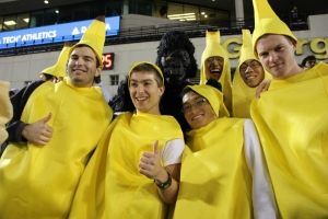 Chen, third from left, posing in his banana suit at the 2011 Homecoming game