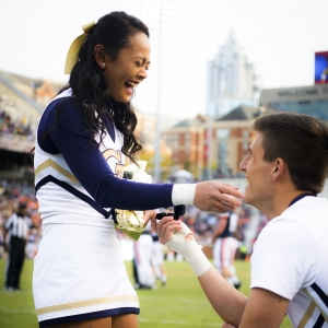 ISyE undergrad Wilson Harmond proposes to his girlfriend, Dana Francisco (ChBE), on Senior Day at the football game against Virginia. The couple are both Georgia Tech cheerleaders.