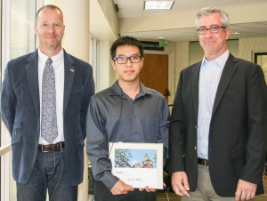 ISyE School Chair Edwin Romeijn and Associate Chair for Graduate Studies Alan Erera with Ph.D. student Simon Mak, recipient of the Alice and John Jarvis, Ph.D. Student Research Award