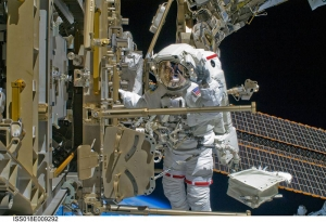 Shane Kimbrough, ISyE grad and current commander of the International Space Station, makes repairs to the ISS. (Photo credit: NASA)