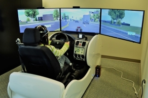 Srinivas Peeta developed this simulator to understand how drivers think and process information behind the wheel. The work has grown to include correlating brain activity and eye movement with what drivers say they think and do behind the wheel.