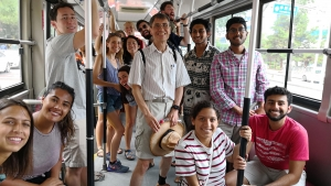 A group of ISyE students take public transportation in Shanghai.