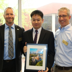 H. Milton and Carolyn J. Stewart School Chair Edwin Romeijn and Associate Chair for Graduate Studies Alan Erera with Xiaolei Fang, winner of the Alice and John Jarvis Ph.D. Student Research Award