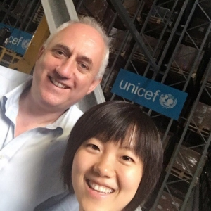 Yuxi Wu at the UNICEF Supply Chain Division fully automated warehouse in Copenhagen, Denmark, with Paul Molinaro, who is the Chief of Supply Chain in the MENA regional office.