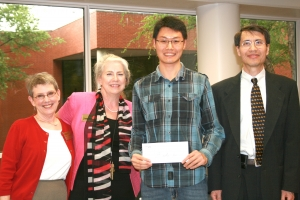 Zihao Li, recipient of the Alpha Pi Mu Academic Excellence Award, standing with Patti Parker, Jane Ammons, and Chen Zhou (L to R)