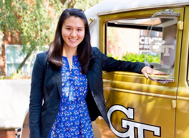 ISyE Student Veronica Chua next to the Ramblin' Wreck 1930 Ford Model A Sport