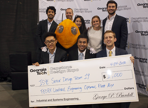 Spring 2018 Senior Design Finalists with Buzz holding a check
