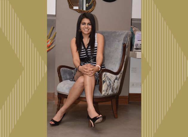 Natasha Jain Elevates sitting in a chair