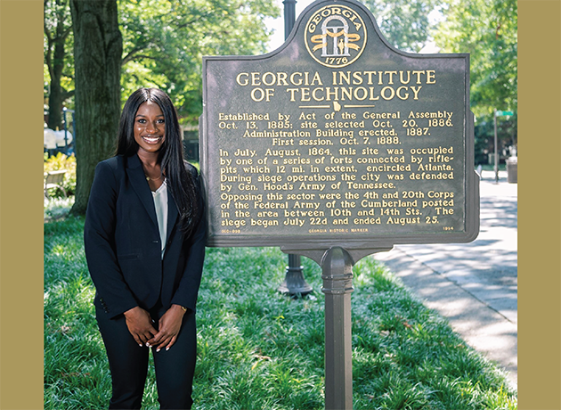 Ndeyanta Jallow standing in front of a Georgia Tech sign