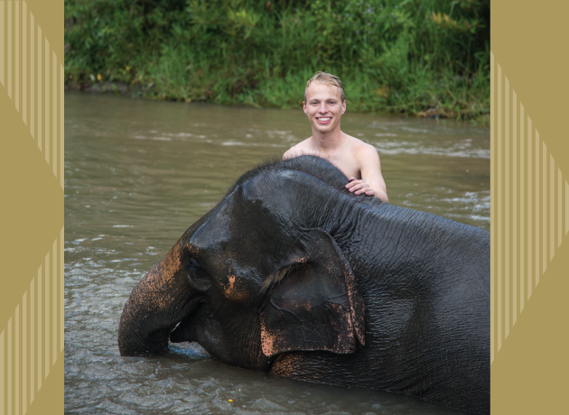 ISyE third-year Andrew Yowell visiting an elephant reservation in Chiang Mai, Thailand